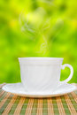 White cup with saucer on straw napkin Royalty Free Stock Photo