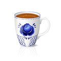 White cup of tea with blue floral ornament Royalty Free Stock Photo