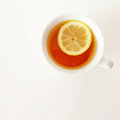 White cup of tea with lemon a piece photo taken iphone Royalty Free Stock Photography