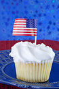 White cupcake with USA flag Royalty Free Stock Image