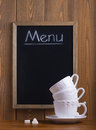 White cups and chalk board Stock Images