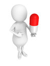 White 3d man with red medicine pill. first aid concept Royalty Free Stock Photo