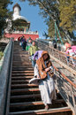 White dagoba in beijing china march th chinese people and buddhist monk on a stairs leading to bai ta pagoda or stupa and shanyin Stock Photos