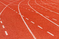 White dash line on red running track Royalty Free Stock Photo