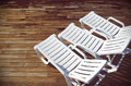 White deck chairs top view of three empty in a swimming pool Royalty Free Stock Photos