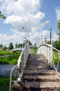 White decorative bridges through park stream sky Royalty Free Stock Image