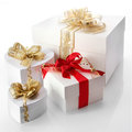 White decorative gifts including hearts collection of heart shaped boxes with elegant gold ribbons tied with braid and pearls on a Stock Photo