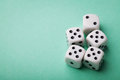 White dice on green table. Gambling devices. Copy space for text. Game of chance concept. Royalty Free Stock Photo