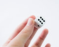 White dice hand showing on light gray background Royalty Free Stock Image