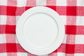 White dish on checkered table cloth Stock Photos