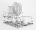 White dishes drying on metal dish rack Royalty Free Stock Photo