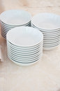 White dishes on a table ready for breakfast Royalty Free Stock Photo