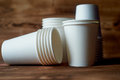White disposable paper cups for coffee and tea.A lot. Royalty Free Stock Photo