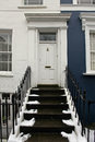 White door entrance on residential house with doorstep Stock Photos
