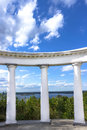 White doric columns blue sky with clouds Royalty Free Stock Photo