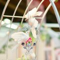 White doves holding golden rings in their beaks beautiful decoration for a wedding reception two Royalty Free Stock Photo