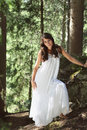 White dressed woman in the woods beautiful posing natural light portrait Royalty Free Stock Photos