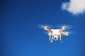 White drone flying in the sky Royalty Free Stock Photography