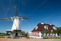 White Dutch windmill Stock Images