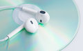White earphone on music dvd Stock Photo