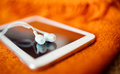 White earphones and tablet pc close up photo small dof Stock Photography