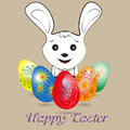 White Easter bunny and colored eggs Royalty Free Stock Photo