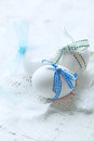 White eggs with blue ribbons easter decoration Royalty Free Stock Photos