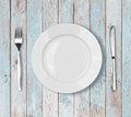 White empty dinner plate setting on blue wooden table Royalty Free Stock Photo