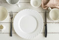 White empty dishes on wooden table with copy space Royalty Free Stock Photo
