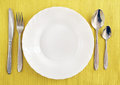 White empty plate with fork, spoon and knife Royalty Free Stock Photography