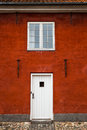 White Entry Door and Window in Red Brick Building, Close Up, Exterior Royalty Free Stock Photo