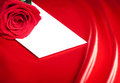White envelope and red rose Stock Images