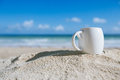 White espresso coffee cup with ocean , beach and seascape Stock Images
