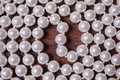 White female beads on a dark brown background Royalty Free Stock Photo