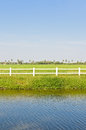 White fence green field Royalty Free Stock Image