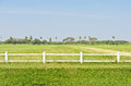 White fence green field Royalty Free Stock Photo