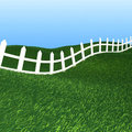 White fence and green grass Stock Images