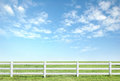 White fence on green grass Royalty Free Stock Photo