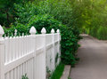 White fence and green street view of elegant on a beautiful Royalty Free Stock Image