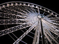 White Ferris Wheel over dark night sky Royalty Free Stock Photos
