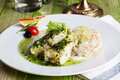 White fish with pesto sauce and meat plate in a Royalty Free Stock Photo