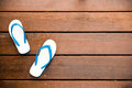 White Flipflops on a wood background Royalty Free Stock Photo