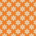 White floral ornament on orange. Seamless pattern