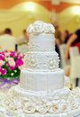 White floral wedding cake on restaurant background Royalty Free Stock Image