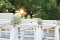 White flowers, Rustic Chic outdoor chair  Autumn wedding decoration Royalty Free Stock Photo