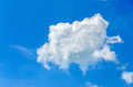 White fluffy cloud, blue sky background, clear summer outdoor