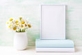 White frame mockup with chamomile bouquet in rustic vase and boo