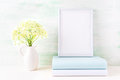 White frame mockup with pale mint book Royalty Free Stock Photo