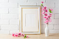 White frame mockup with pink flower bunch Royalty Free Stock Photo