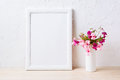 White frame mockup with pink and purple flower bouquet Royalty Free Stock Photo